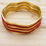 pulsera dorado zircones rojo