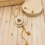 juegos dorado resina blanco  corbatero